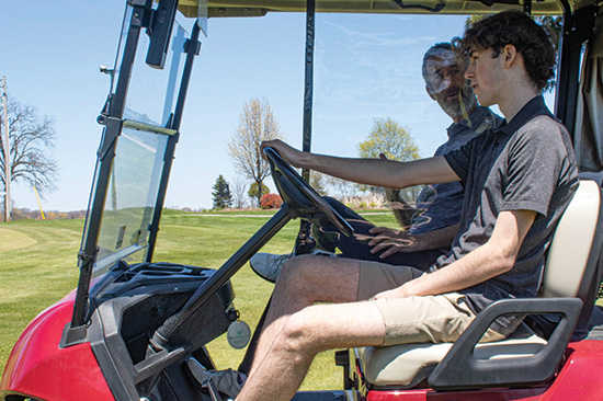 The Golf Cart Divider in use - Passengers in cart