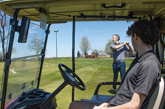 The Golf Cart Divider in use - passenger watching
